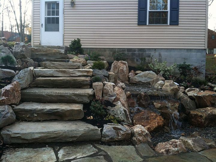 You can see the waterfall coming from the left to the right under the stone stairs
