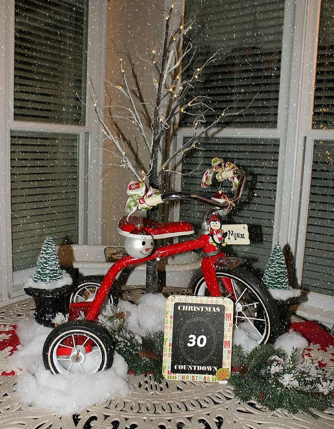 I wanted a vintage tricycle for the centerpiece. Fortunately, I found this at a friend's booth. Thanks for stopping by the Christmas porch!