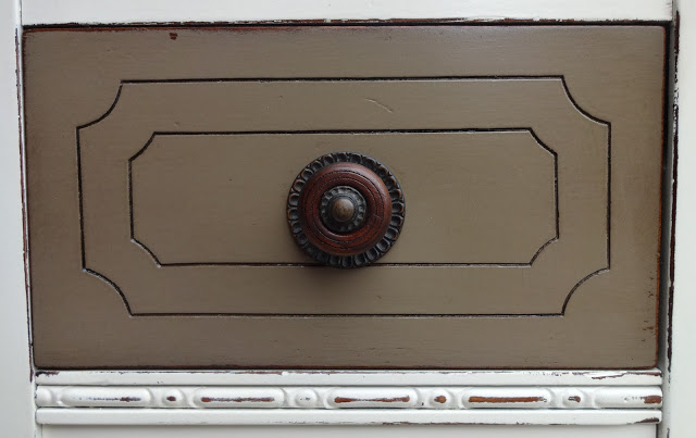 I used Virtual Taupe from Sherwin Williams for the drawers and door and then stained over it with Dark Walnut to deepen the color.  I also restored the original knobs with Danish Oil.