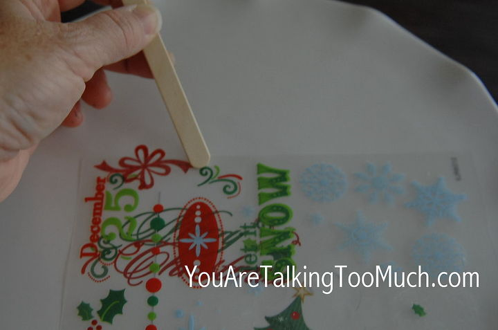 I share how I use Dollar Tree rub-on transfers to give my standard plates a little Christmas cheer. http://youaretalkingtoomuch.com/2012/11/christmas-cake-plates-decorating/#