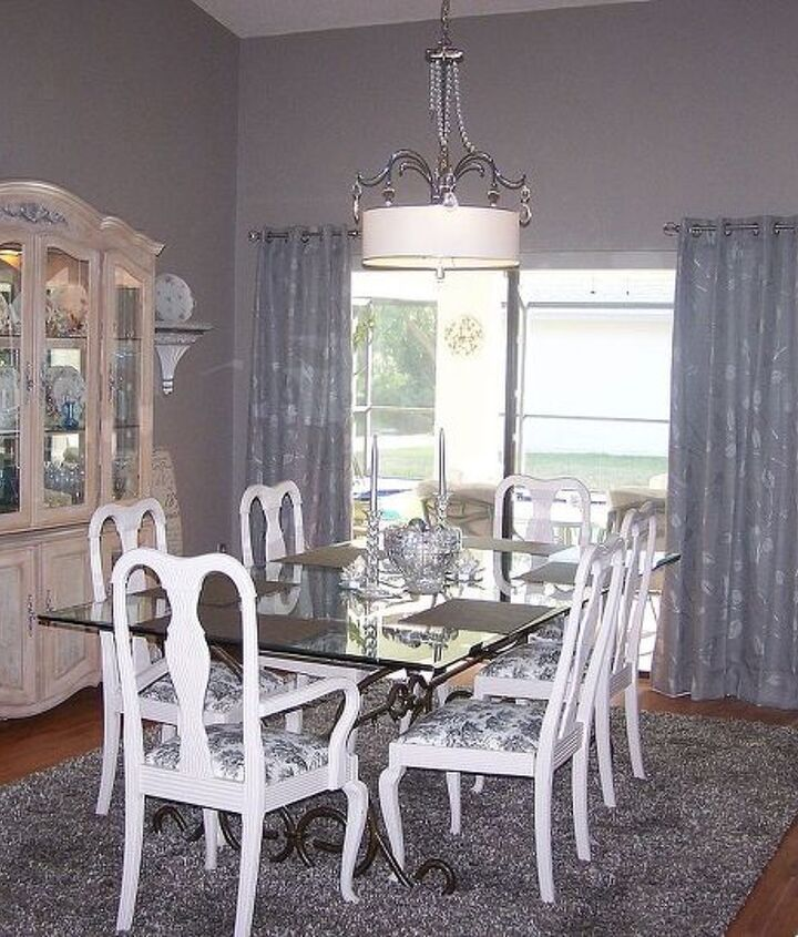This is my dining room table and chairs. They where given to me. I painted the chairs and recovered the seats