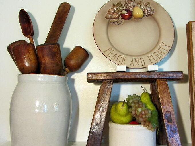 an early fall mantel coconut oil treatment on vintage wood, repurposing upcycling, seasonal holiday d cor, A bouquet of vintage wooden utensils in a crock All treated with coconut oil