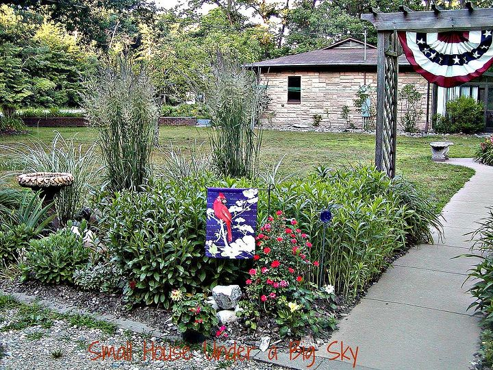 Perennials beds with birdbath for water, beauty and habitat.