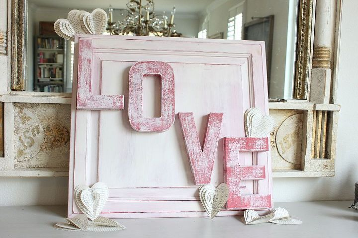 love sign made from an old cabinet door, crafts, painting, repurposing upcycling, seasonal holiday decor, valentines day ideas, An old cabinet door found curbside was transformed with Paper Mache letters and some CeCe Caldwell paints