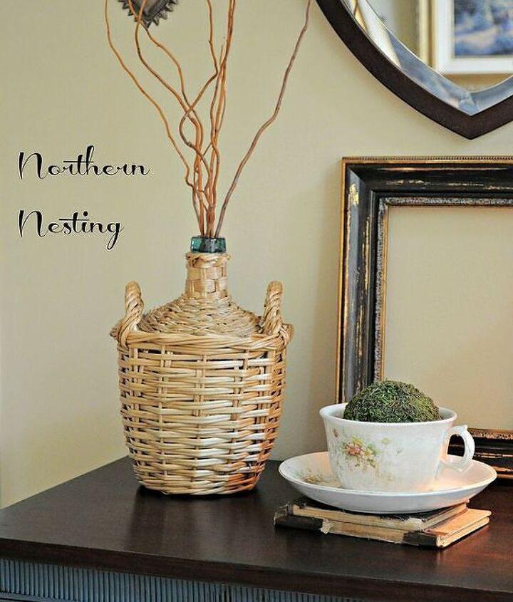 a new vignette adding a vintage demijohn, home decor