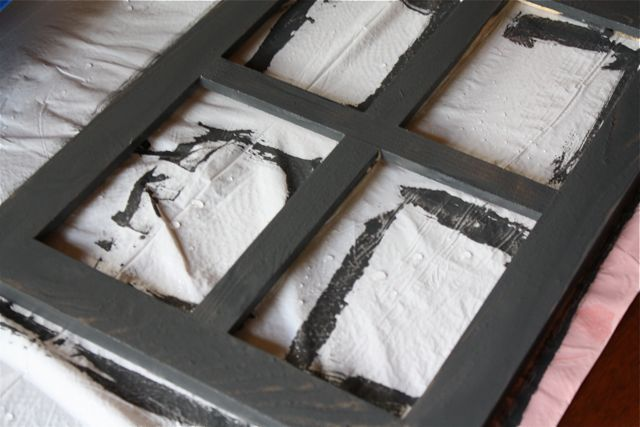 Paint the frame with water. Mix some black and white paint together and paint it on the frame.