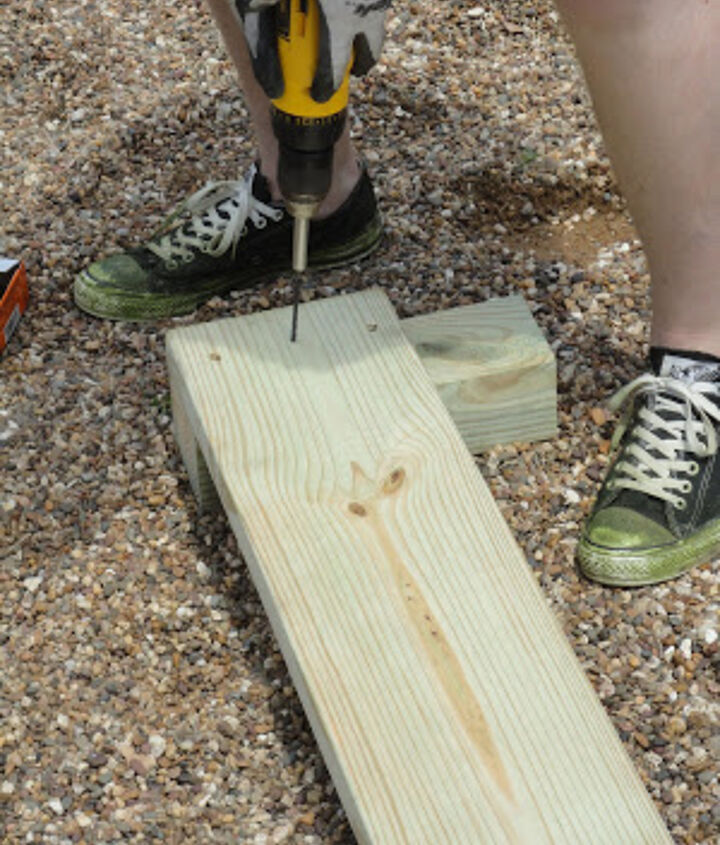 Secure boards to make a large rectangle. Add legs to secure down into ground.