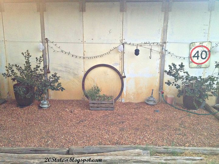 how to pretend to hide an ugly garden shed, curb appeal, succulents, Potted plants an old iron ring and brand