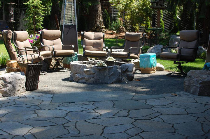 Stone fire pit, gravel patio, paver patio all blended to create a beautiful outdoor space. By Ross NW Watergardens in Portland, OR.