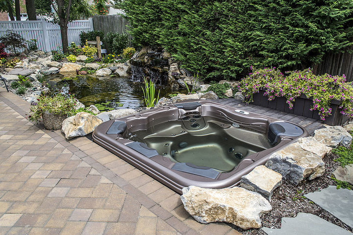 Imagine yourself sitting in the warm soothing water with a ground level view of this pond and waterfall. http://www.deckandpatio.com/DP_Blog/