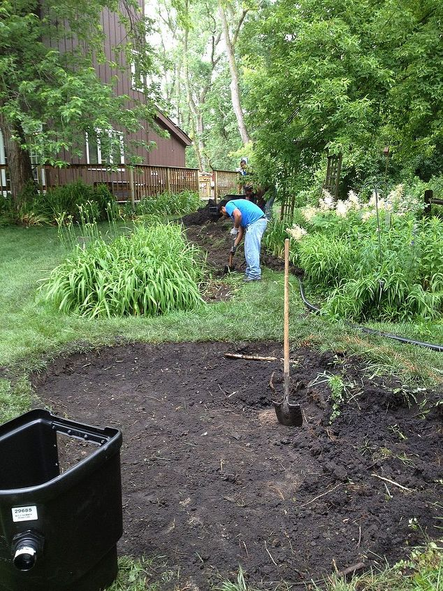 Re-digging and shaping the pond. Adding a 25' stream