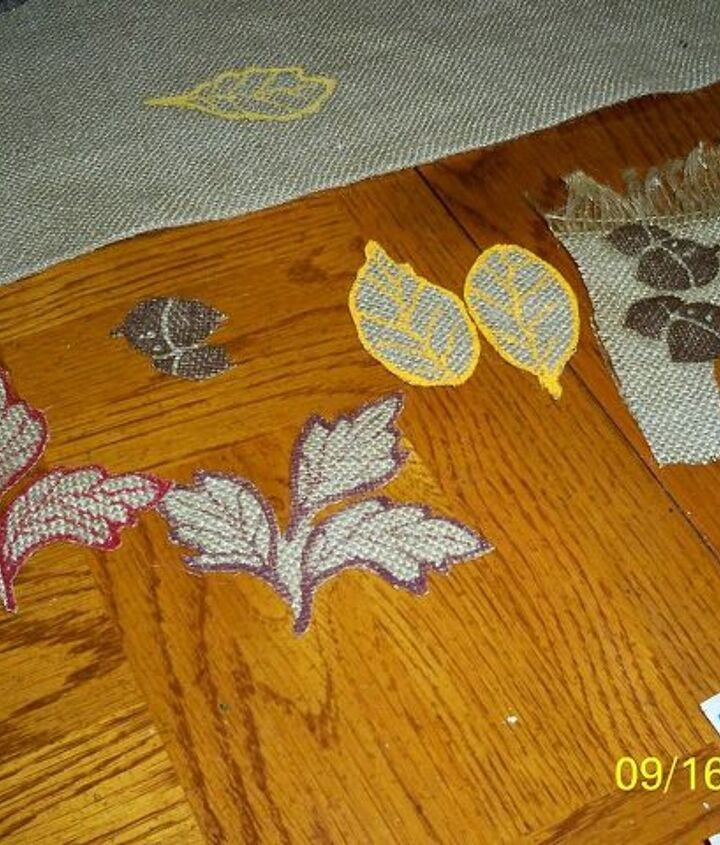 The Modge Podge drys clear - yeah!  I added veining on the leaves and then used stitch witchery to attach the leaves. In retro spect, I should have just stamped them onto the runner. Remember, this WAS going to be a mantle scarf!