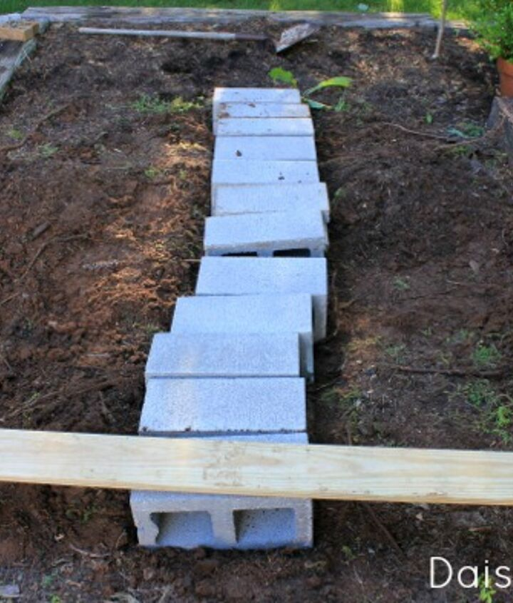 I used concrete blocks as the support between the railroad ties.
