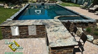 , Concrete pool with built in spa bar stools and automatic safety cover