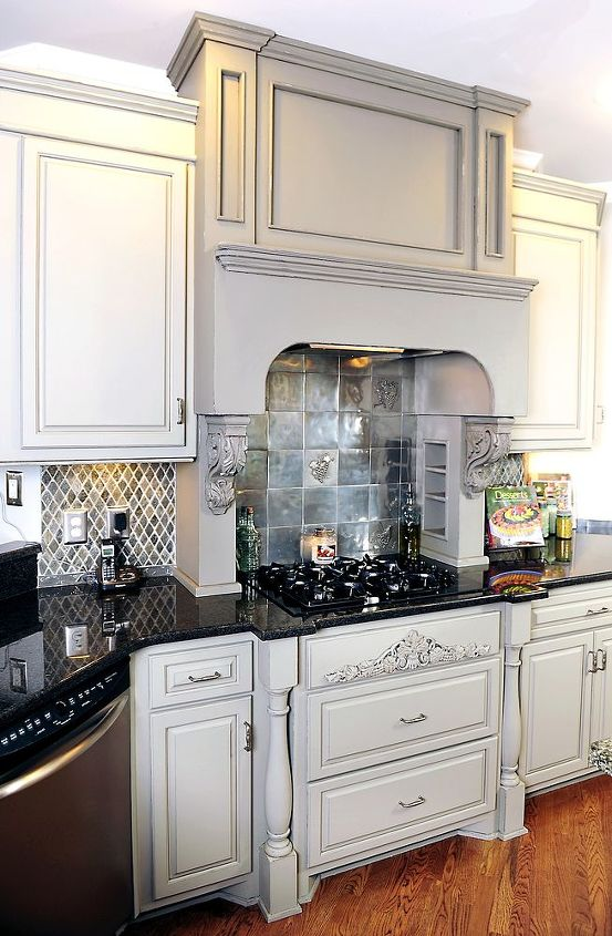 We used a color one shade darker than the cabinets on the stove hood to add a little contrast and make it a focal point.