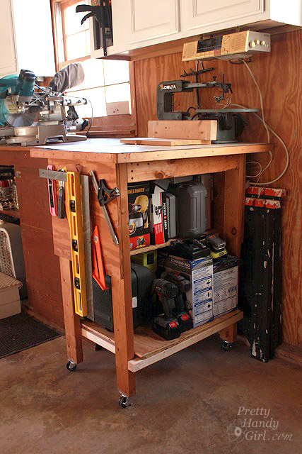 Rolling power tool work bench houses all the small power tools.