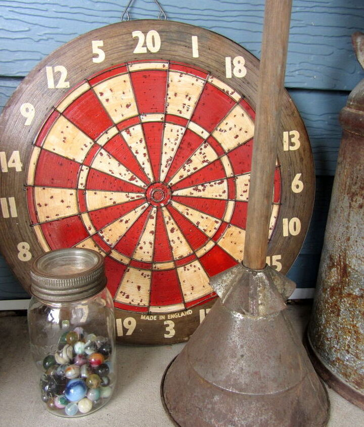 Marbles, laundry stompler and a vintage dart board.