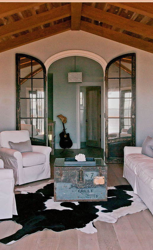 At the top of the stairs on the 3rd fl, a remarkable pair of antique doors graces the entry to the large family room. Imported from a church in France for the project, the 9 ft. tall doors feature distressed oak and antique mirrors.