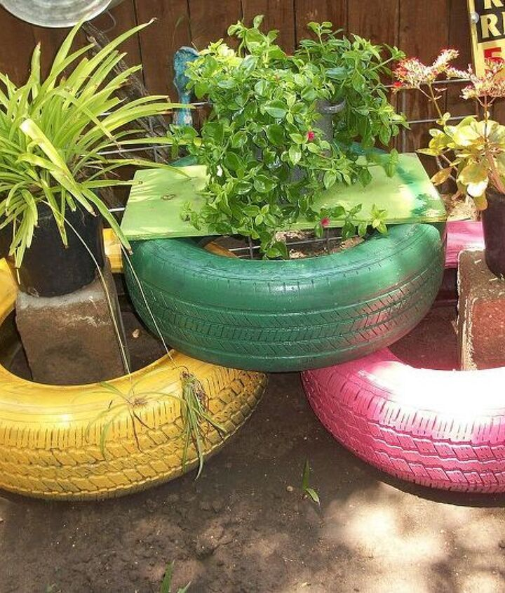 I finally had some time to spray paint old tires to add color to my back yard