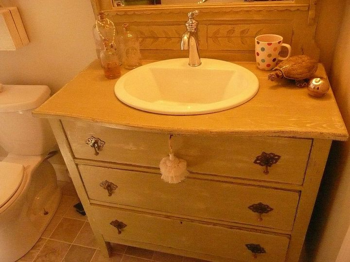 This old dresser has been converted to a vanity. It was my first selection for the bath, and all other materials were selected to compliment the color and style-vintage cottage in a soft green shabby finish.