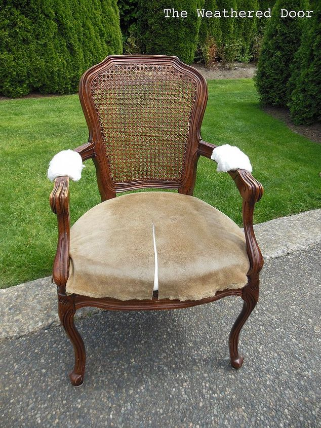 Chair before. Nailhead trim removed and fabric on arms removed.
