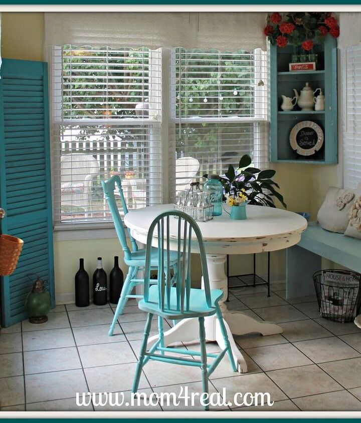 Aqua, white, red, and yellow accents all come together to give this breakfast nook the perfect cottage feel.