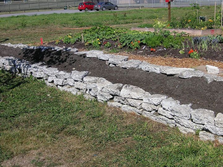 The wall is three layers high and not mortared. As it was built, each layer was laid to lean just slightly toward the center of the garden to prevent tipping. Safety is paramount.
