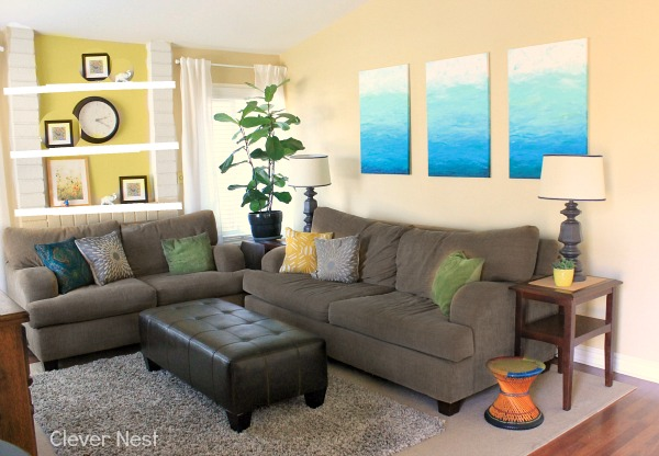 i need your help what does my living room need, home decor, living room ideas, gray couch yellow accent wall and shelves