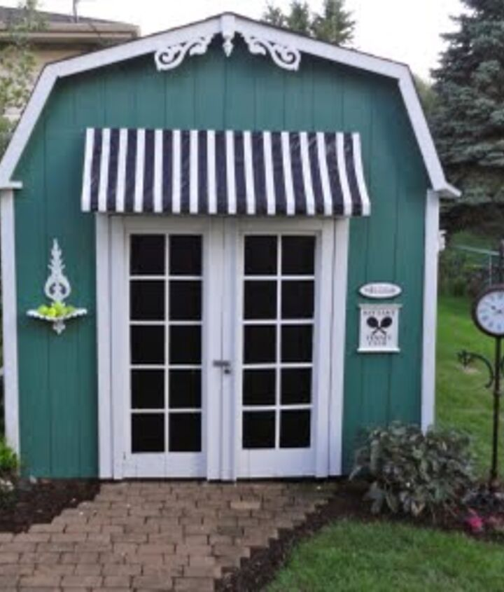 """Here is my finished product.  It is not a """"tennis club"""".  Total cost was only $40.  I made the awning out of a tarp and masking tape and furring strips.  Such a difference for a little effort and money."""