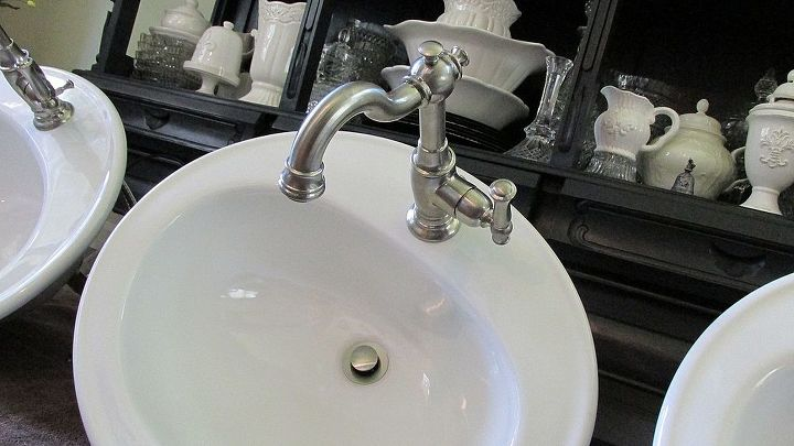 I am in love with these faucets. They are swing spout so we can easily rinse toothpaste down and aids in cleaning of the sink. Love the vintage styling!