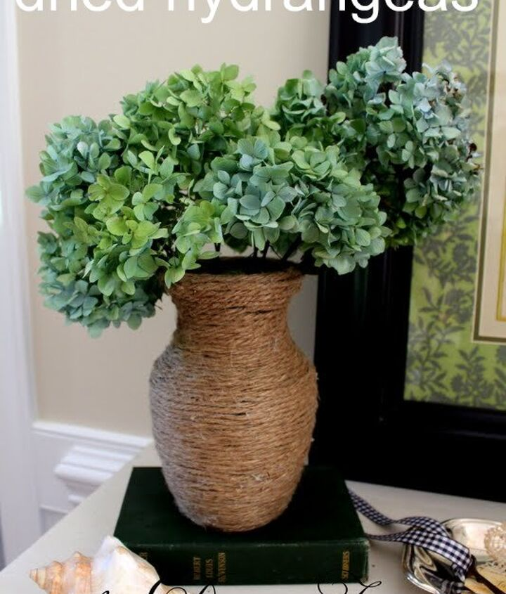 Dried hydrangeas in a jute wrapped glass vase.