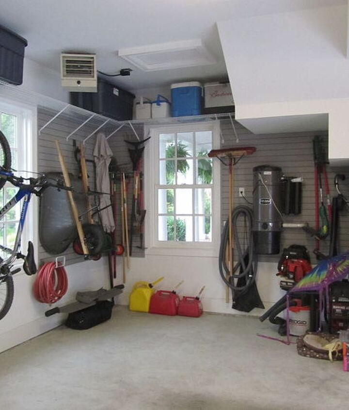 An under-stairs nook provides great garden tool storage!