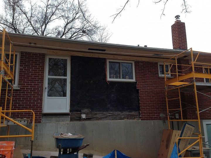 """Exterior demo of the brick to allow for a 3' cantilevered """"bump out"""" of the kitchen."""