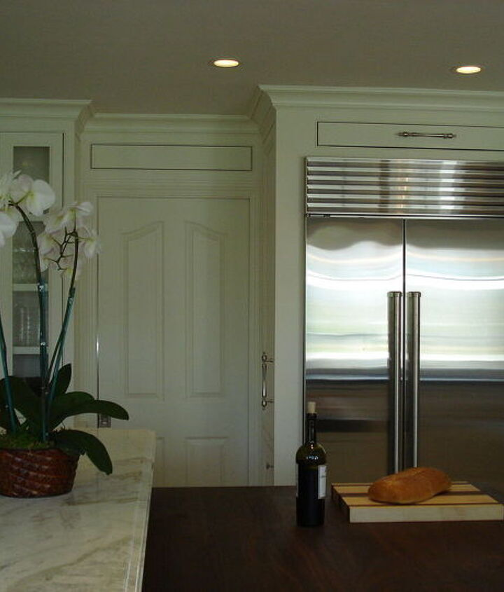 We fabricated the panel above the passage door too! That door goes into the dining room.