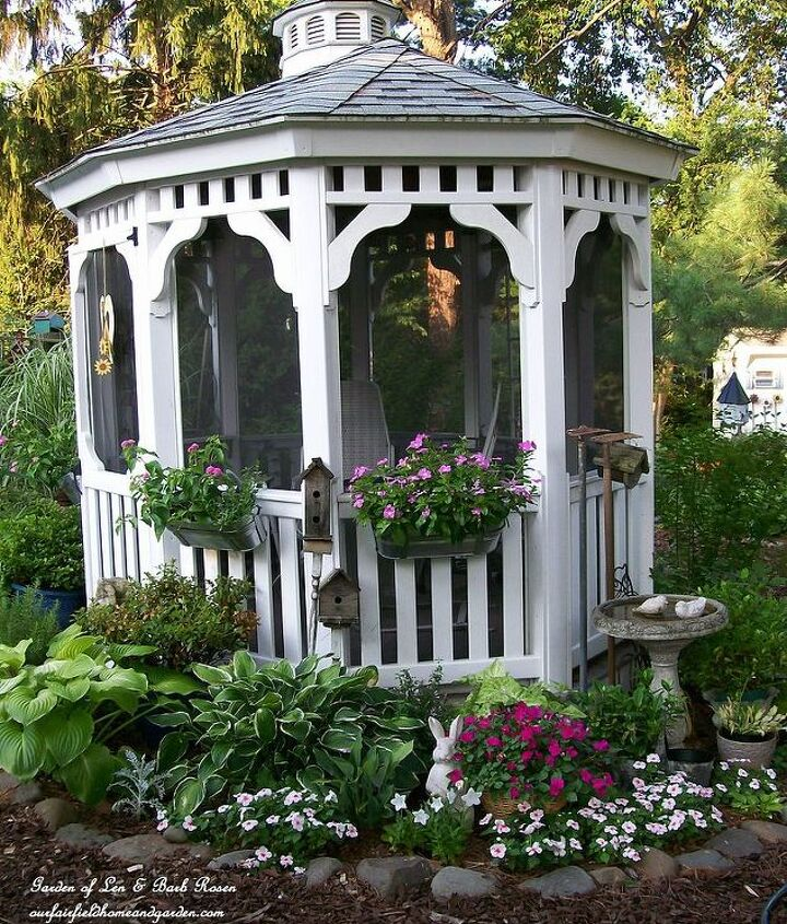 Added IKEA hanging window boxes to our gazebo to bring flower color up off the ground level. See more of our garden at http://ourfairfieldhomeandgarden.com/ or http://pinterest.com/barbrosen/our-fairfield-garden/