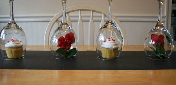 Place a flower or cupcake under each wine glass dome.