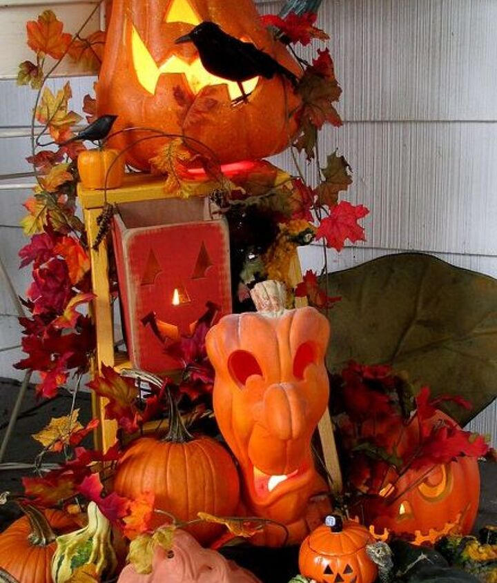 Halloween decorations display on our front porch, a collection of real pumpkins & gourds and lit Jack O'Lanterns.http://pinterest.com/barbrosen/our-fairfield-home/
