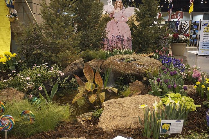 Kindly Good Witch Glinda is standing behind our spouting rock that cascades into a small pond.