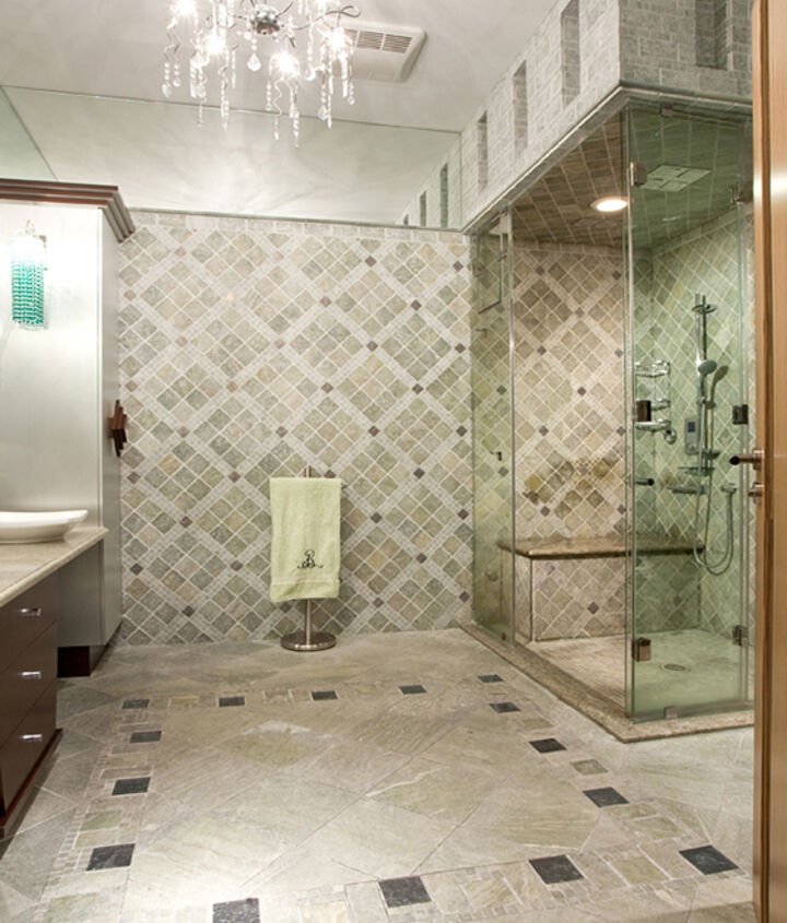 The illusion of complexity of the bathroom tile designs on the walls and the floor are created by manipulation of two tiles and two accessories: metal and glass inserts.