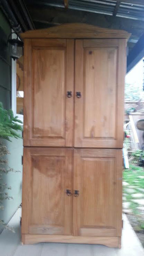 An old and abused pine caabinet