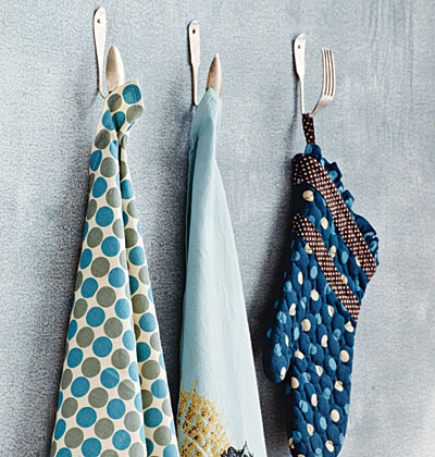 3. Old Silverware- Into Kitchen Towel/Potholder hooks! Heat em up and bend them to your will! A little metal working may be required to drill an hole in the silverware to be able to secure them to the wall or maybe think about...