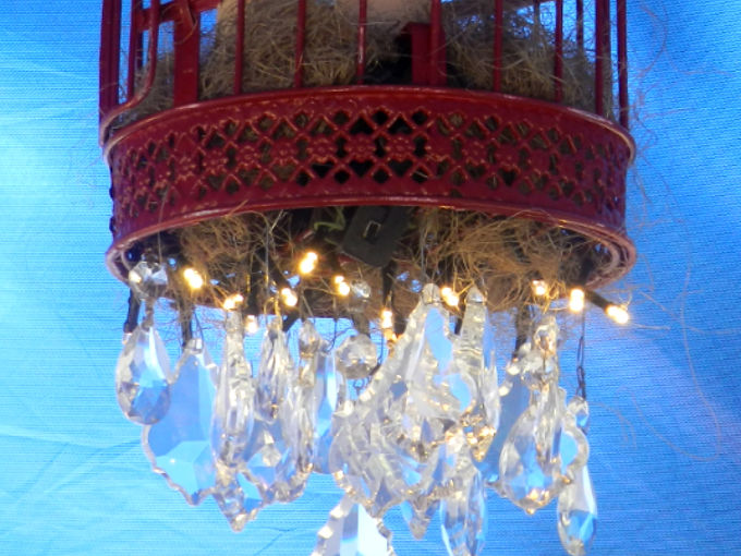 how i diy d an outdoor chandelier, lighting, outdoor living, Since it s a birdcage I put nesting material in the bottom to hide the wires