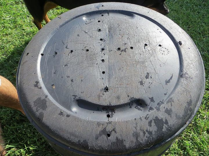 First you'll want to drill holes in the bottom of the trash can. The more holes, the better aeration.