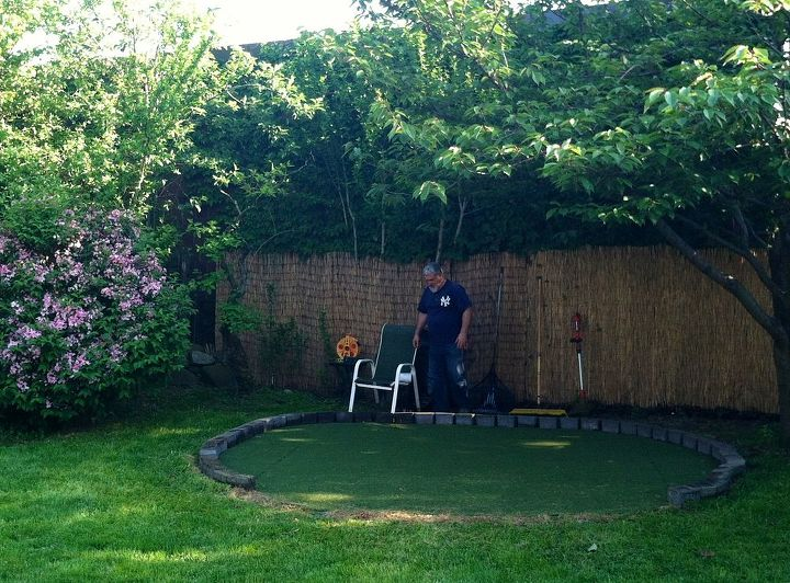 diy backyard golf green my dad s gift to himself for father s day, diy, how to, outdoor living, Here s my Dad Chris finishing up his green