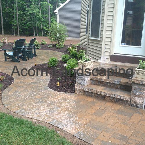 Steps, Techo-Bloc Paver Patio Walkway, Plantings and Water Feature in Greece NY by Acorn Landscaping, Certified Aquascape Contractor of Rochester NY