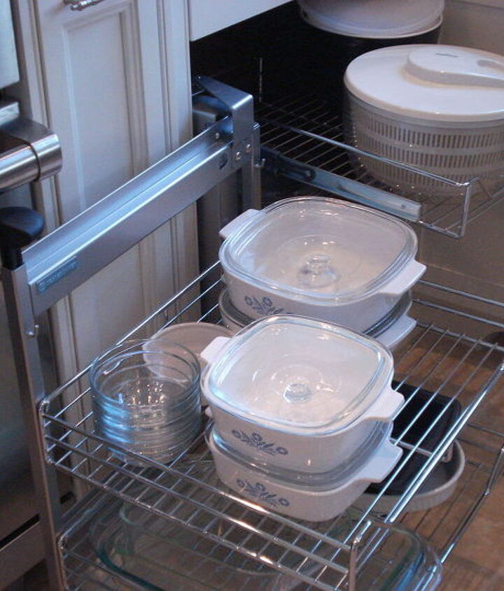 This is a Kesseohmer Magic Corner unit....a great way to solve blind corner storage dilemmas.  This kitchen has one in each corner.