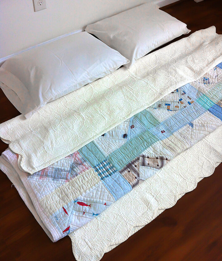 A handmade vintage quilt and pretty vintage bedspread were ready and waiting for the arrival of the box springs that hadn't made it into the house yet.