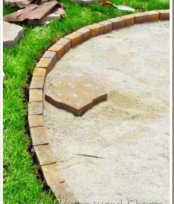 An edging stone was used to keep everything contained at grass level. Plastic edging at garden area. Fill in with more screening.  Tamper  the limestone down, water tamper again.  Best to let sit a couple of days
