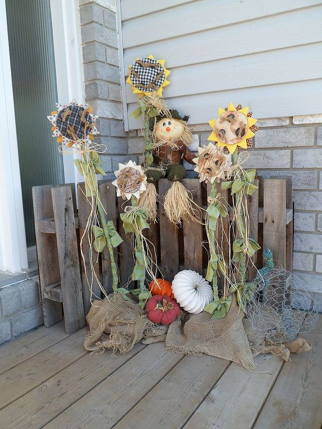 I got the pattern for the sunflowers from a 1997 Country Marketplace magazine. I had planned on making them back then but never got around to it. Those are dryer duct pumpkins I also made laying below the sunflowers.