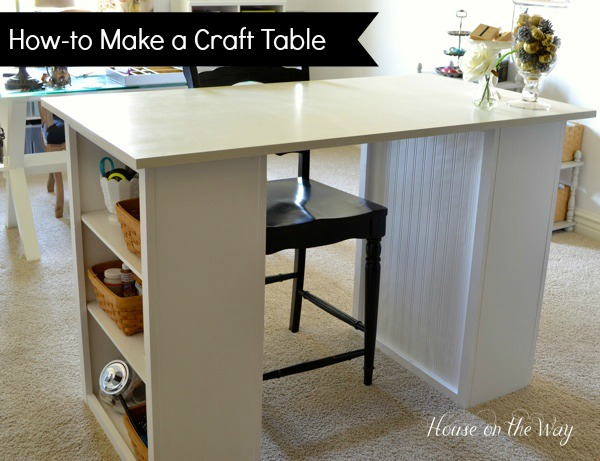 DIY craft table made from two bookcases and a thrift store tabletop.